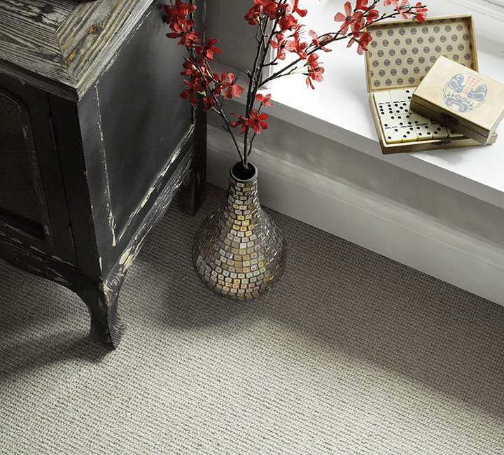 Vase detail on landing fitted with Sisal Weave Cornish Cream carpet by Victoria Carpets