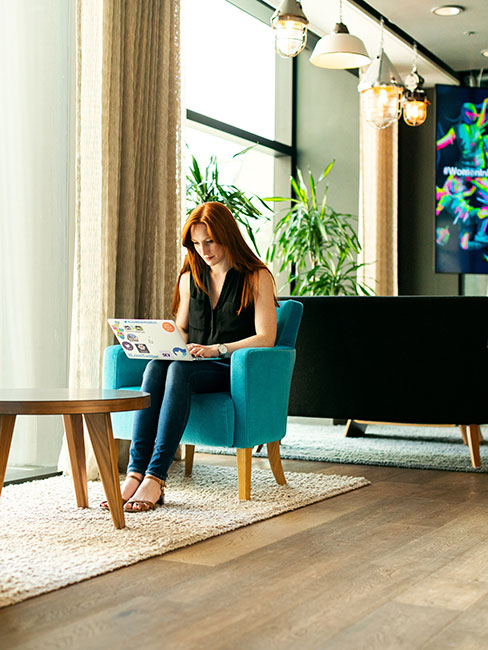 Lady in a hotel reception with impressive contract flooring
